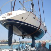 Coating additives provide a boat with biocidal protection from biofouling.