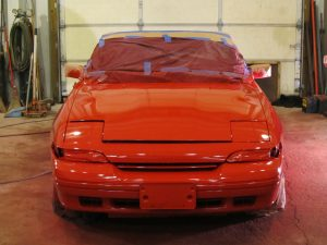 automotive refinish applied as total respray in red