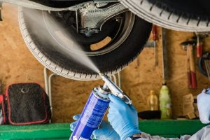 applying underbody automotive coatings with spray