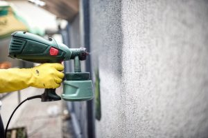 Applying concrete coating with a green spray gun