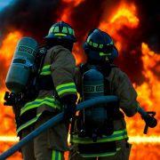 firefighters in a fire with fireproof paint