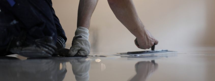 applying floor coating on a concrete floor