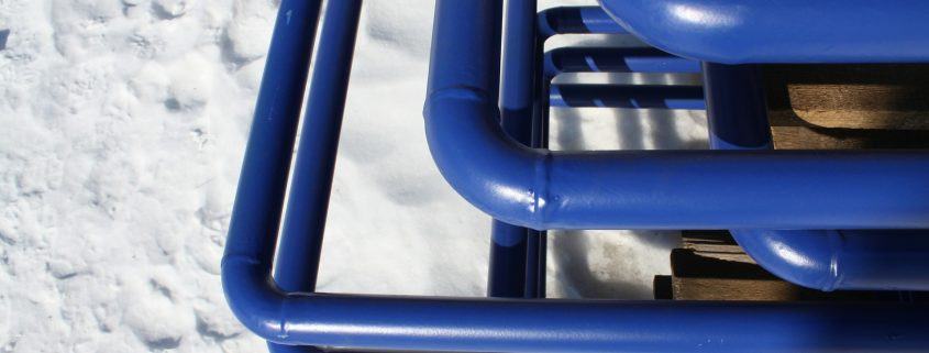 blue pipe coating on pipes in the winter