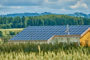 a roof top covered with solar panels coated with solar panel coating