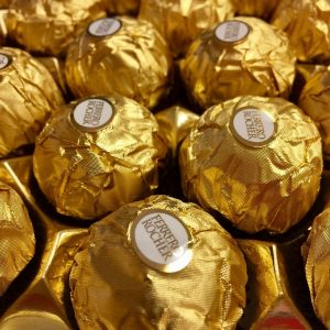candy with wrapping paper treated with packaging coatings for paper