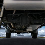 Underbody automotive OEM coatings protect the underside of a vehicle from road damage.