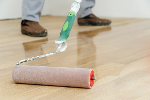 Apply hardwood floor finish
